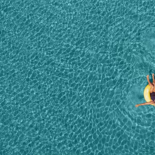 A retirement couple having fun in the sea