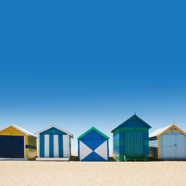 Beautiful bathing houses on white sand beach in Australia
