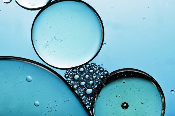An abstract image displaying the integration between oil and water through bubbles